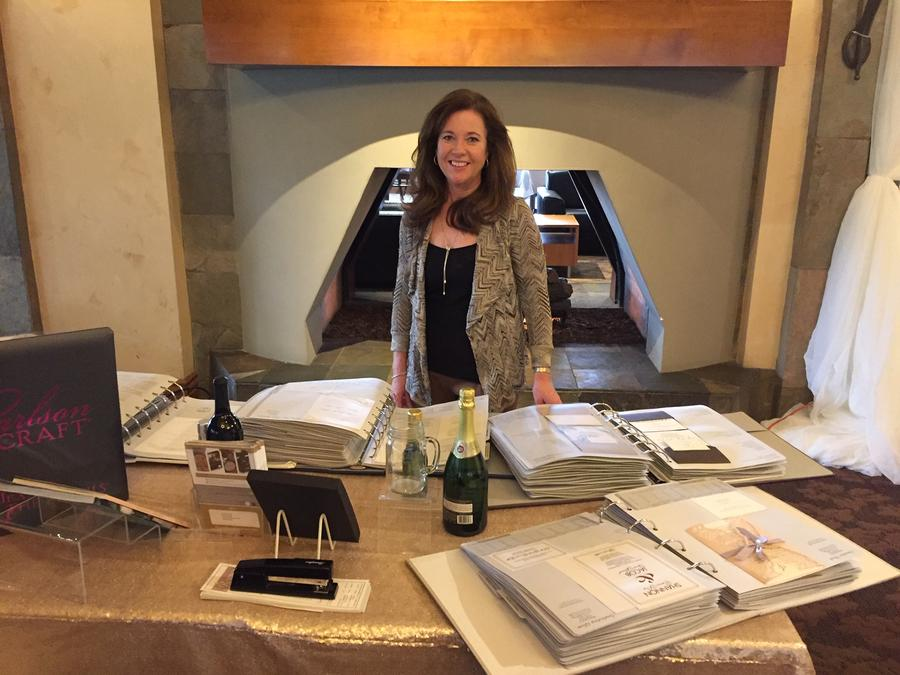 Diane Maeder from Promises West showing wedding invitations in Los Angeles.